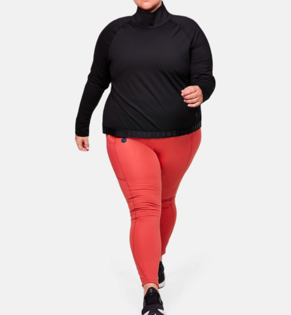 Model wears light pink ColdGear Leggings with a mock neck black top and black sneakers