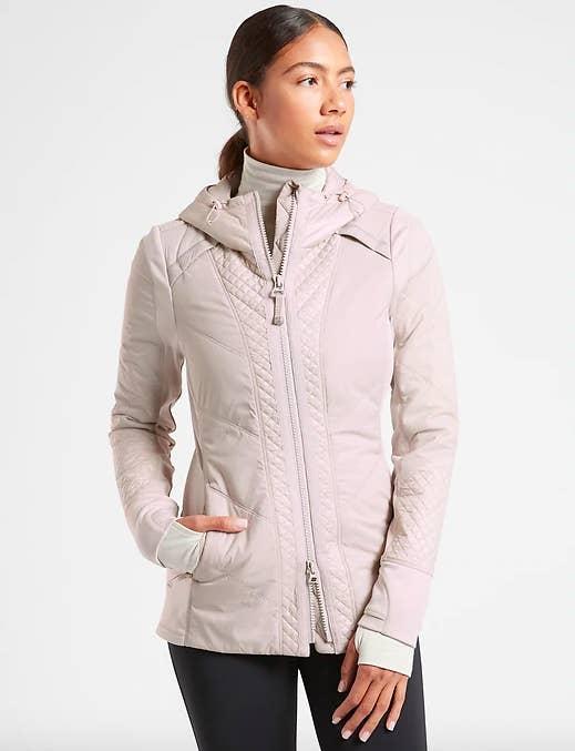 A model wears the rock ridge prima loft jacket in abalone grey