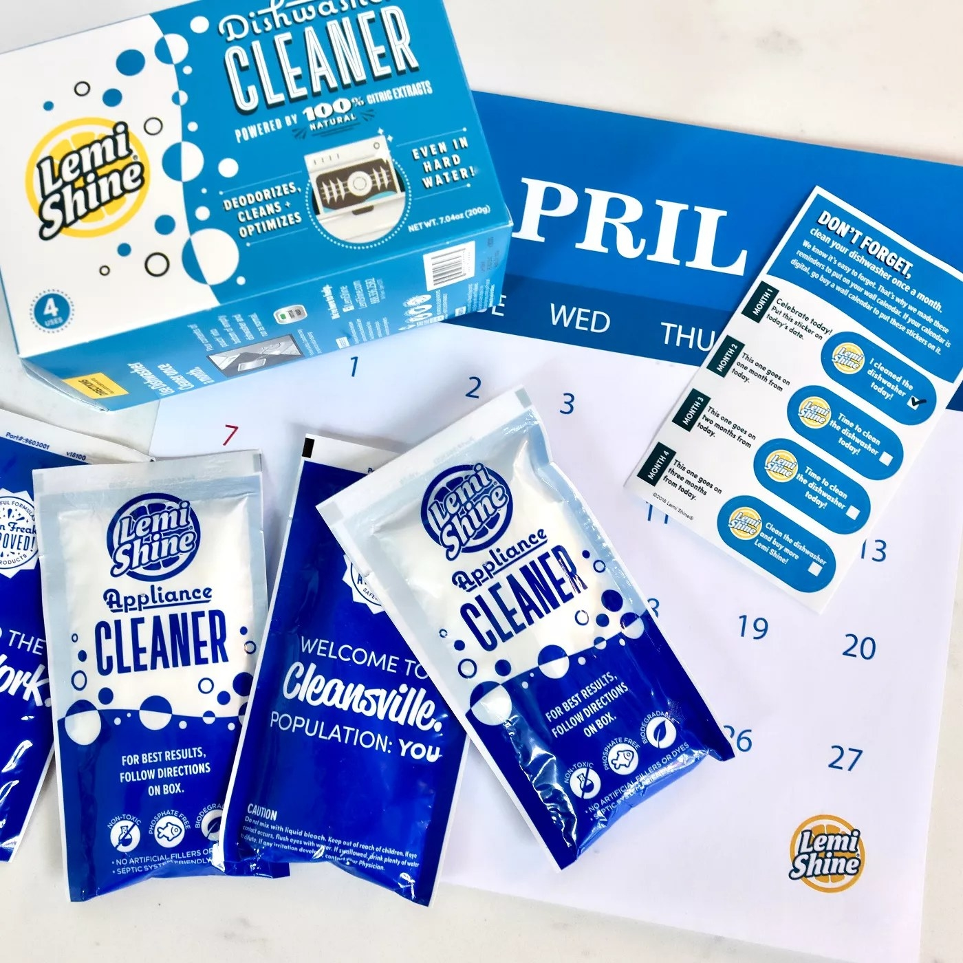The four packets of cleaner and a calender
