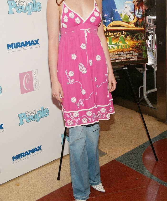 A photo a embroidered pink dress over a pair of light blue bootcut jeans