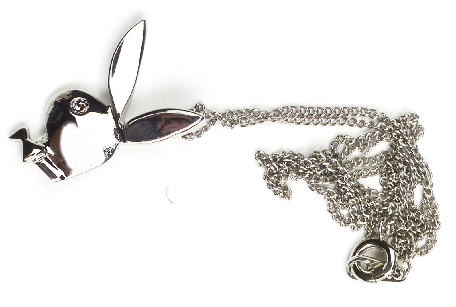 A photo of a silver Playboy Bunny necklace
