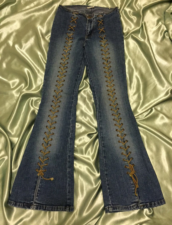 A pair of bootcut jeans with laces going up the entire legs all the way to the top