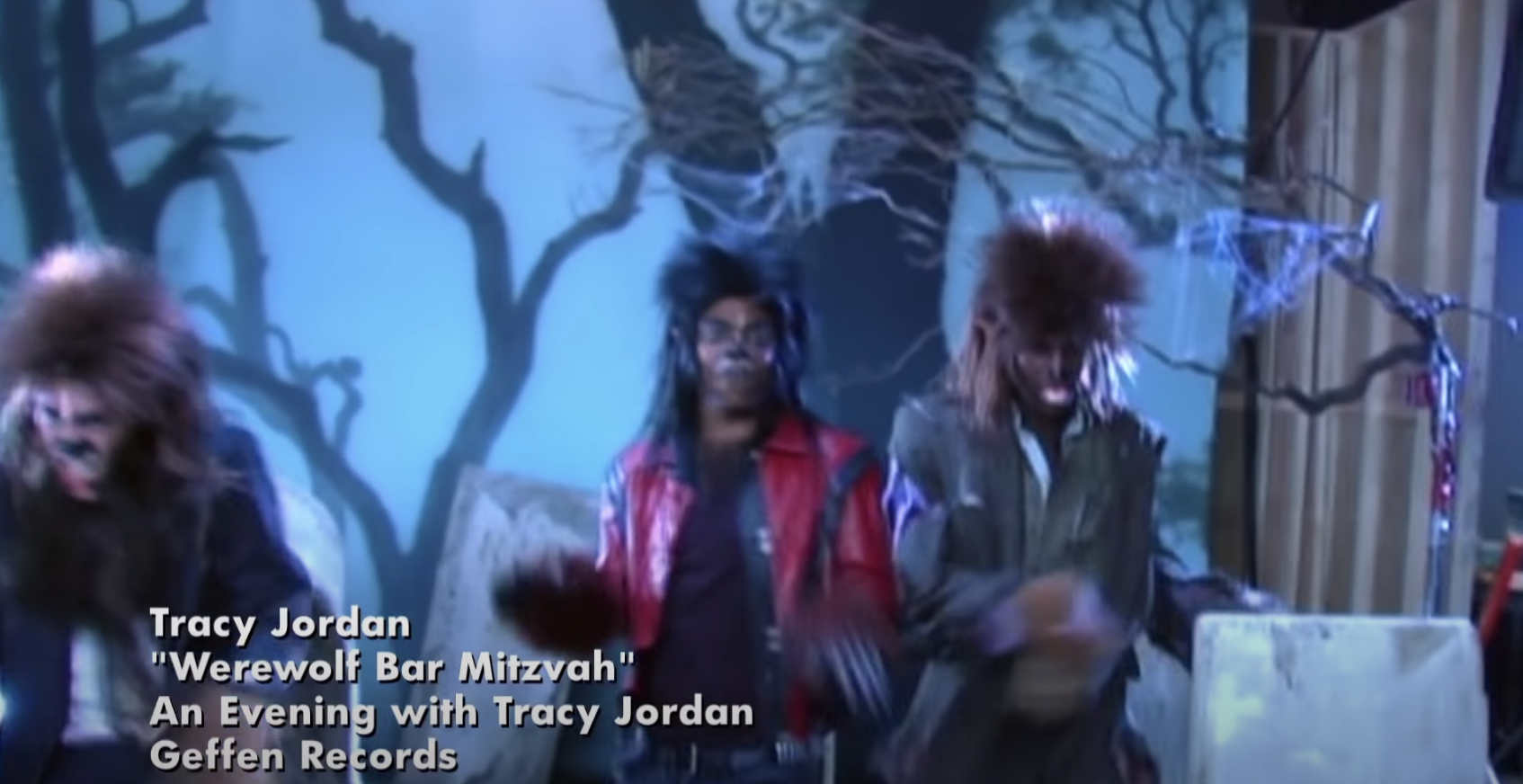 """still from the music video for """"Werewolf Bar Mitzvah"""" in 30 Rock with Tracy Jordan in werewolf costume on a fake woods set"""