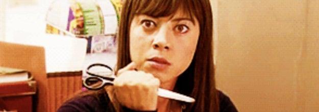 Image of woman holding scissors.