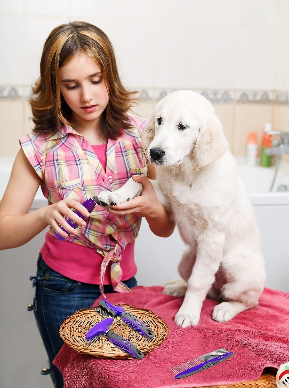 Model using the grinder on a puppy's nails