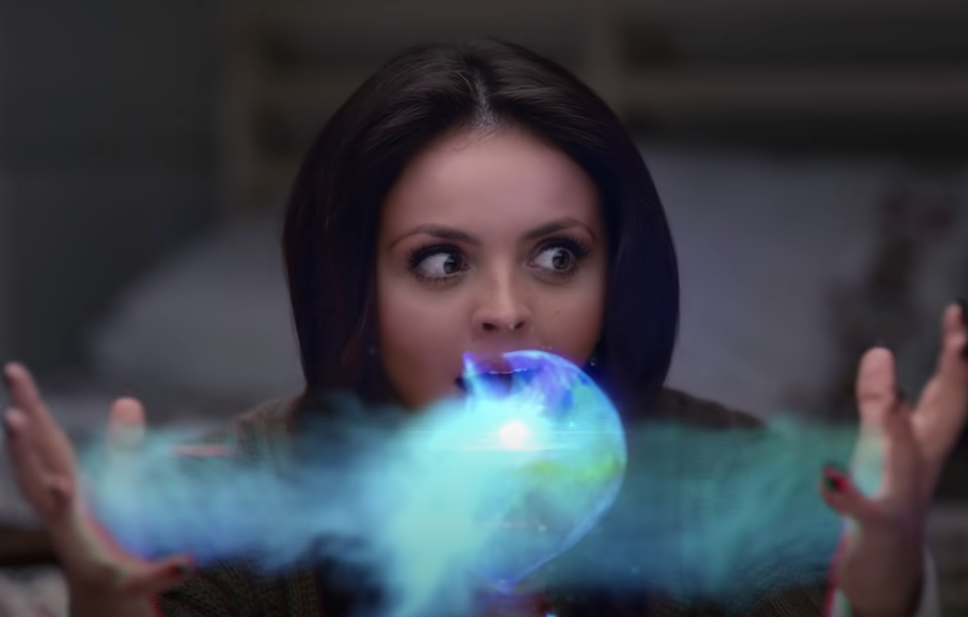 Jesy creating magic blue light in the music video