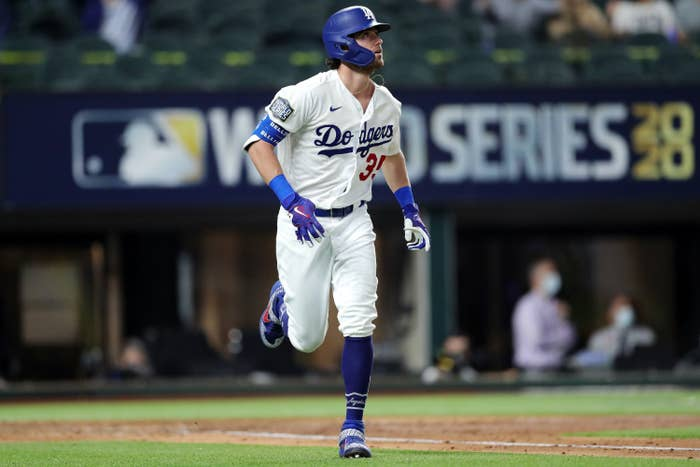 Cody Bellinger, #35 of the Los Angeles Dodgers, watches the flight of his two-run home run in the fourth inning during Game 1 of the 2020 World Series between the Los Angeles Dodgers and the Tampa Bay Rays.