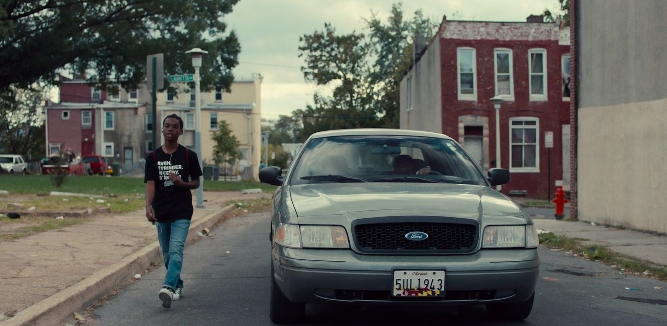 Jahi Di'Allo Winston as Mouse walking down the streets of Baltimore in 'Charm City Kings'