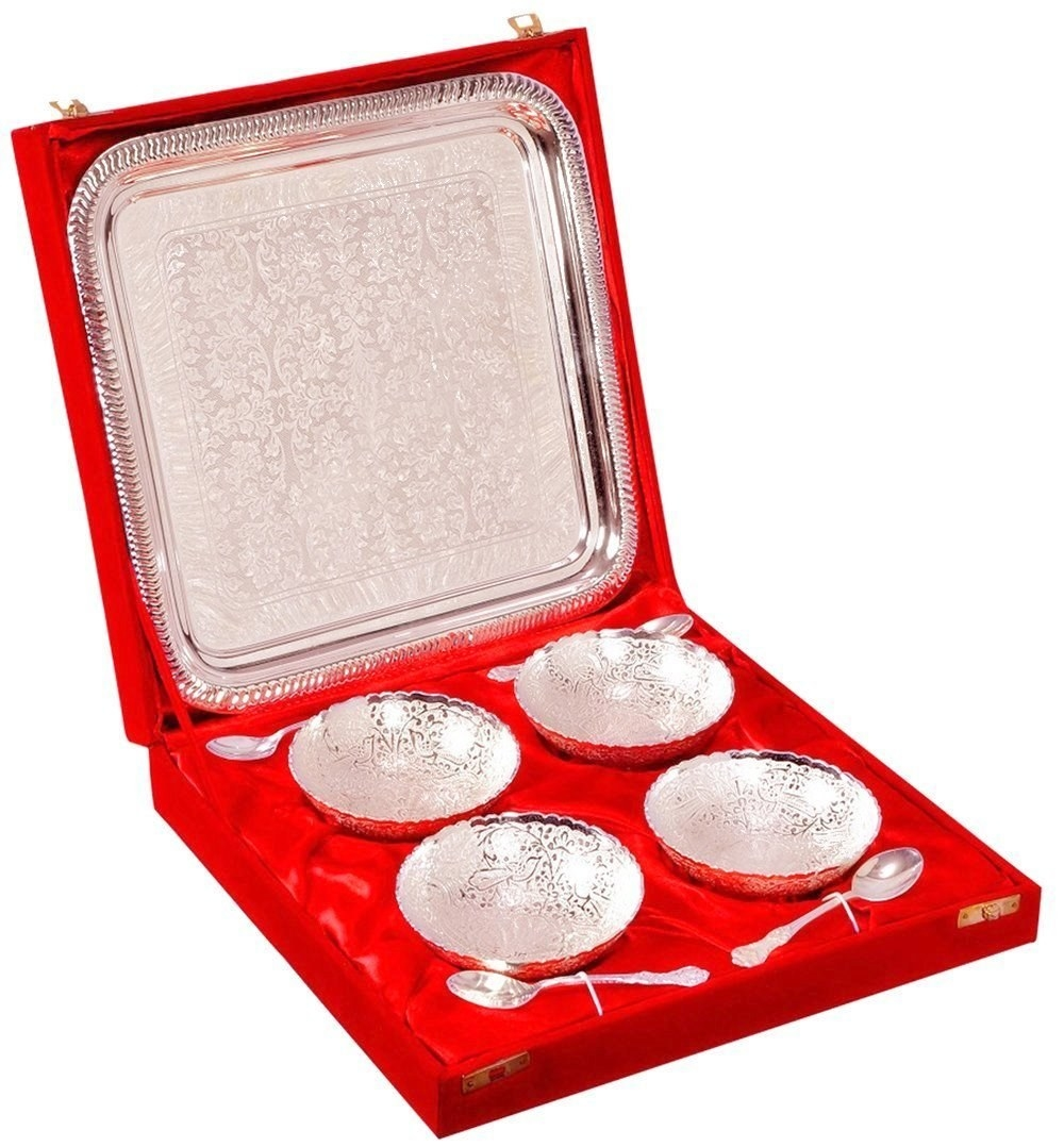 A silver-plated brass plate set