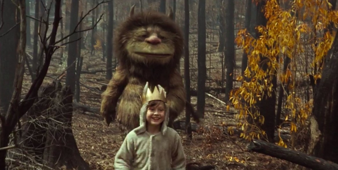 "little boy in crown being chased after by a friendly monster in ""where the wild things are"""