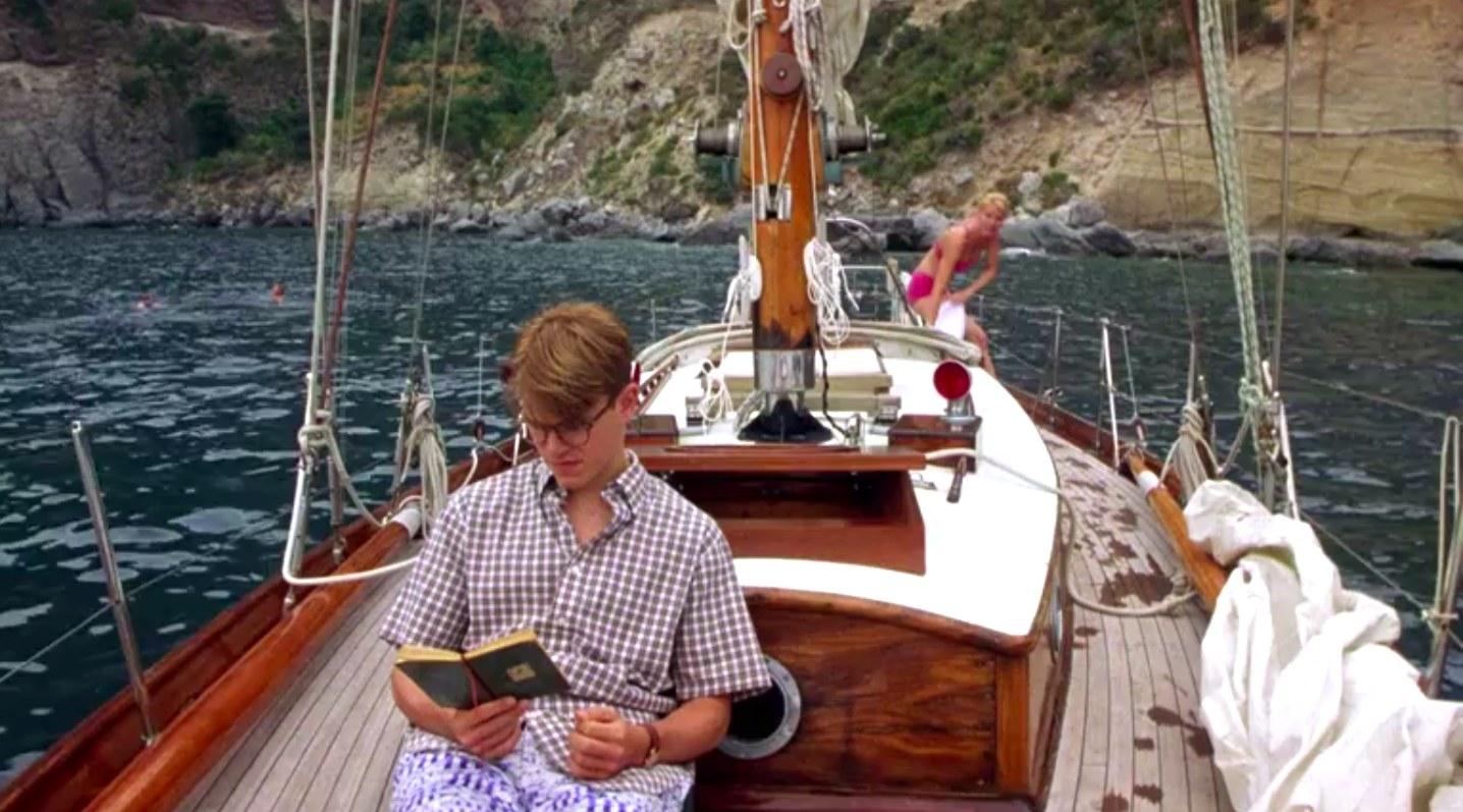 "matt damon reads a book on a boat in ""The Talented Mr. Ripley"""