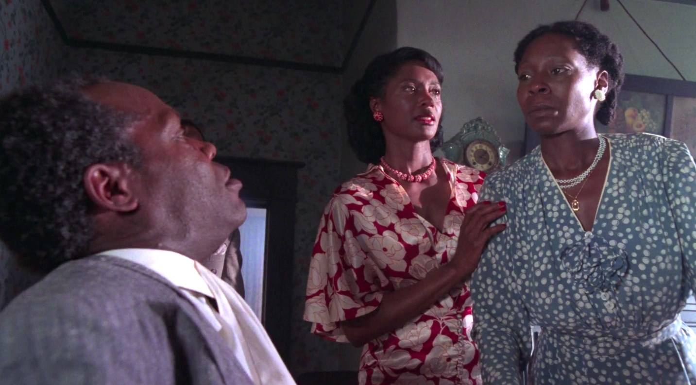 "whoopi goldberg looks over danny glover in ""the color purple"""