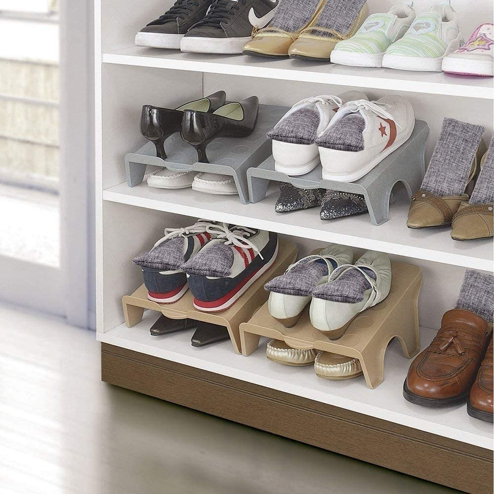 A shelf of shoes with the rectangular deodorizer fabric bags inside