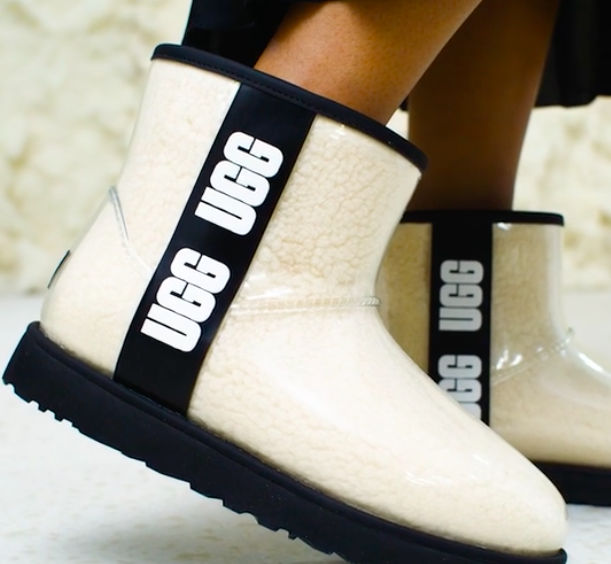 A person wearing the transparent Ugg boots