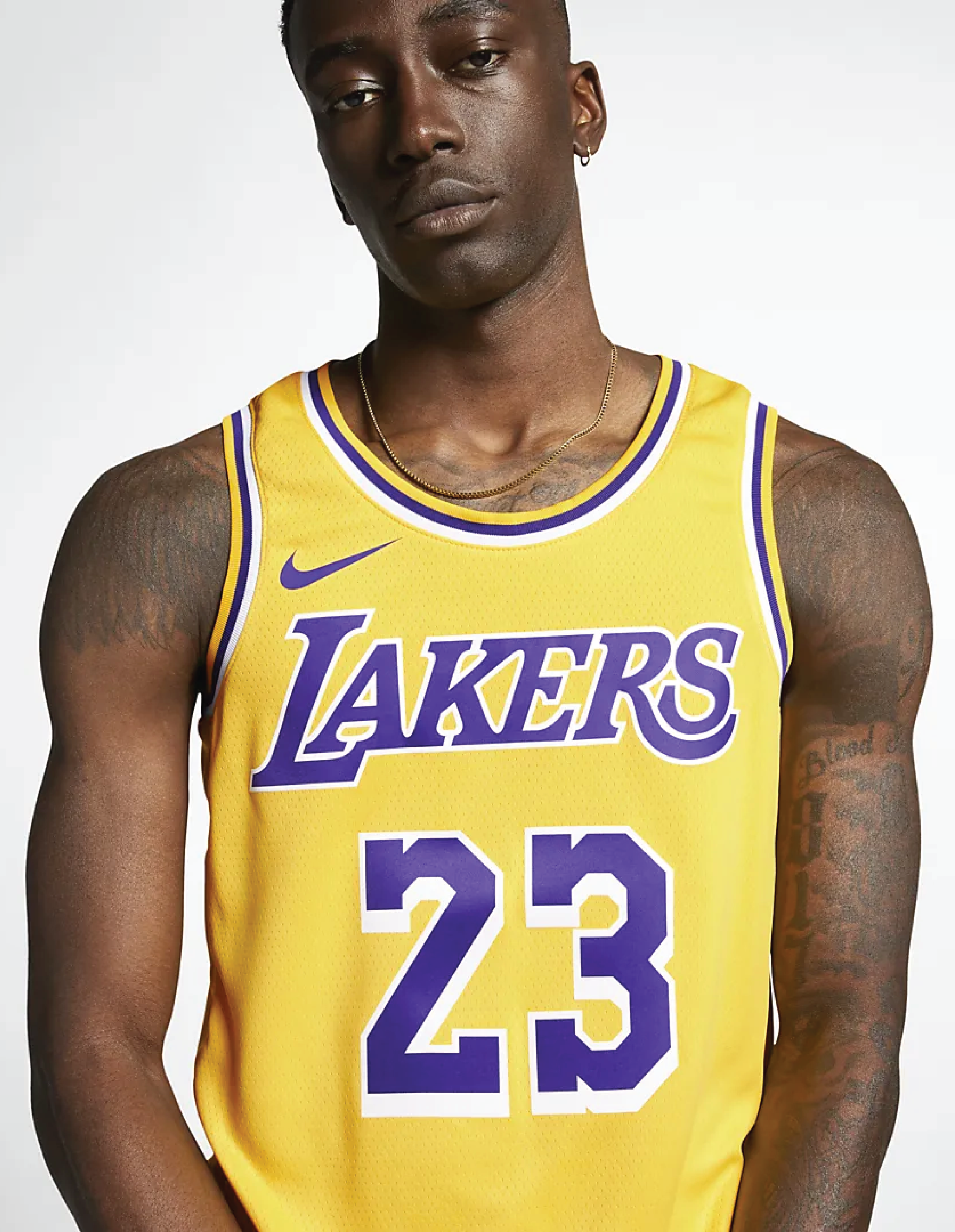 A model wearing the yellow and purple Lakers Jersey with the number 23 in the middle