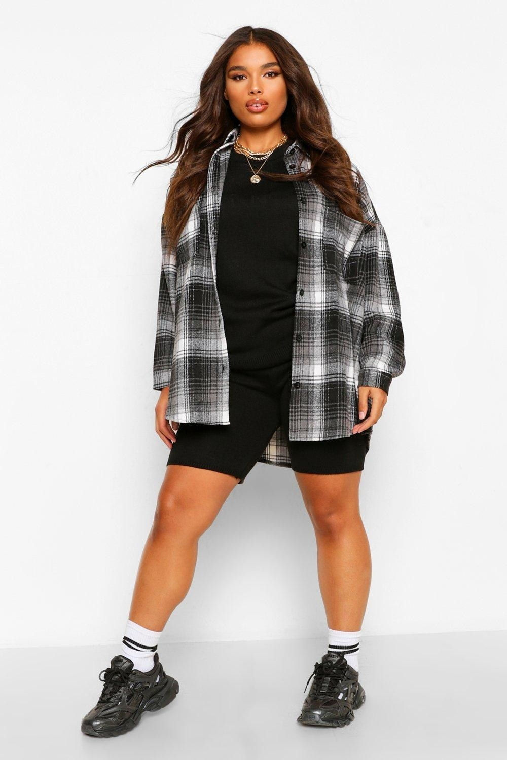 a model in a grey and white plaid flannel