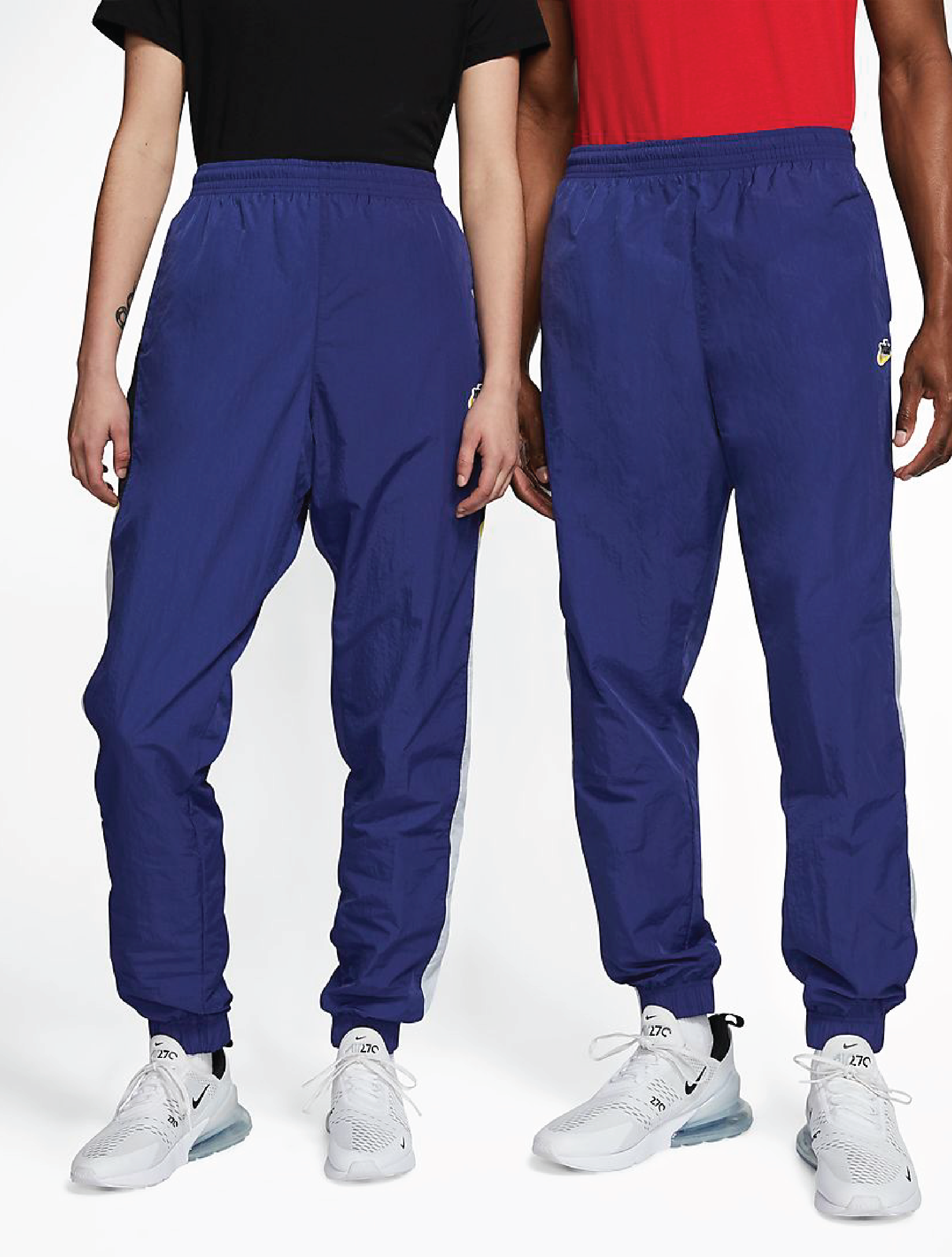 Two models wearing the blue pants with sneakers