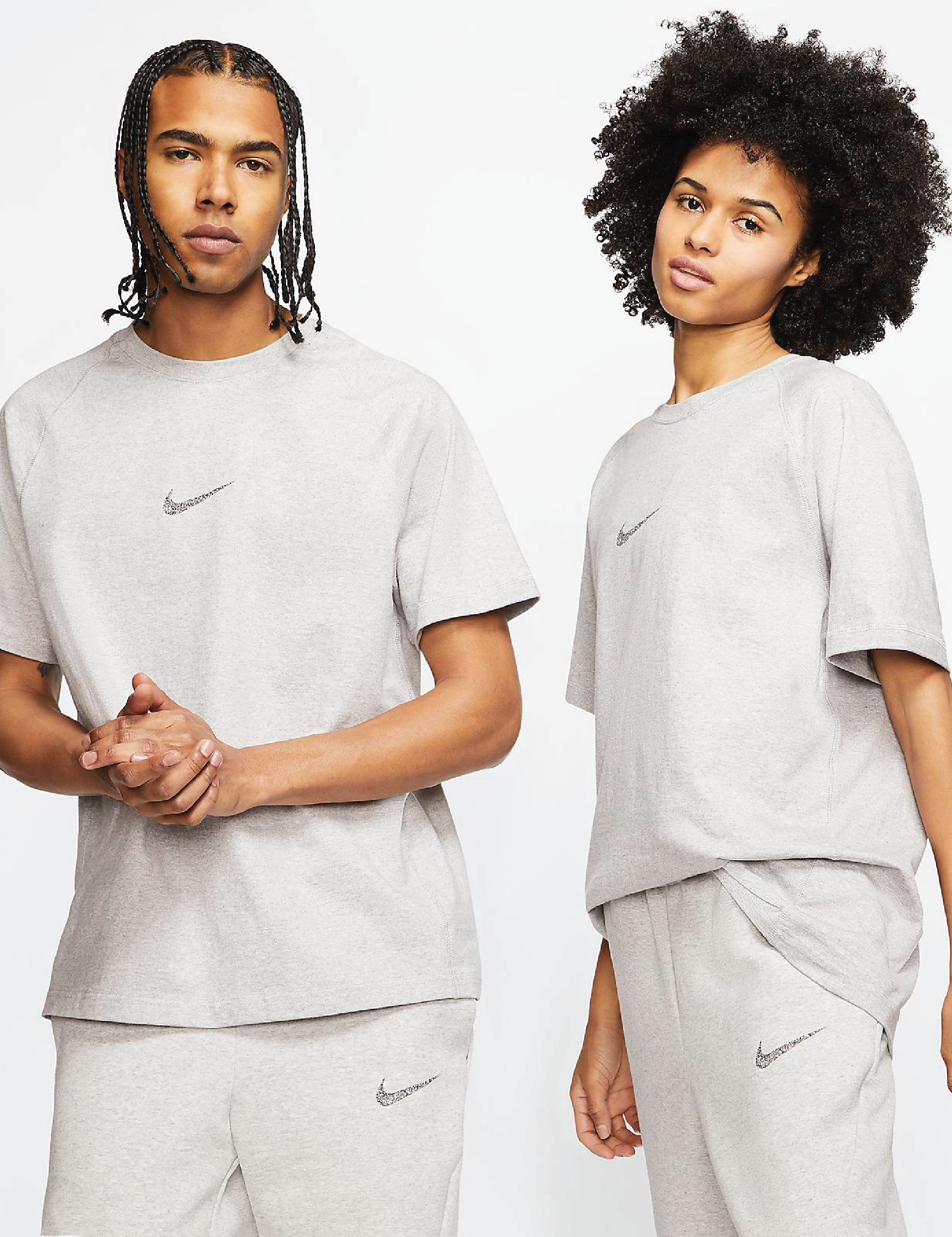 Two models wearing the beige shirt with a Nike swoosh in the center of the chest