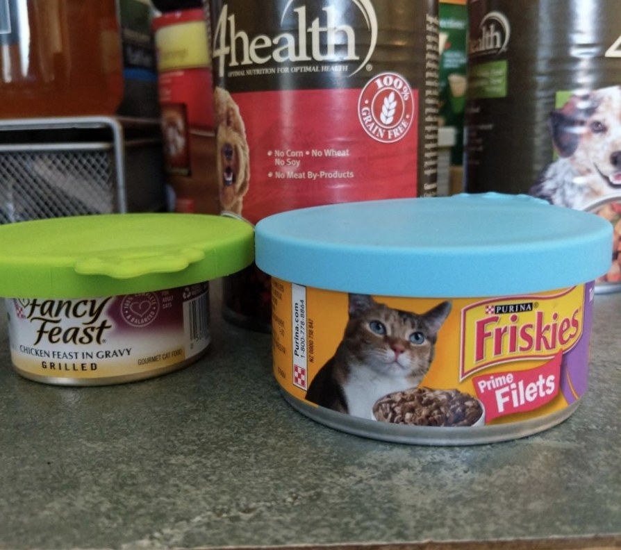 Two cat food cans with silicone lids on top