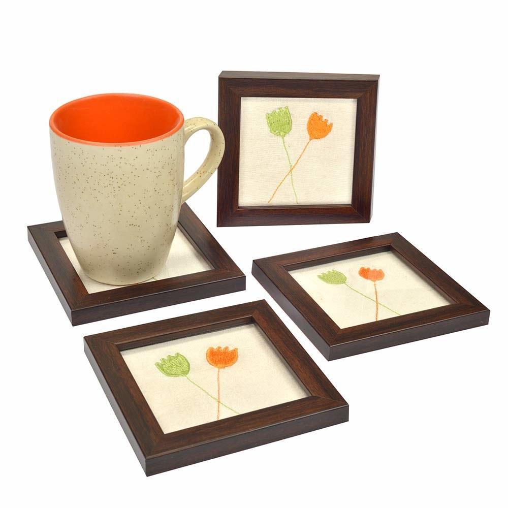 Four coasters, with a mug kept on one of them.