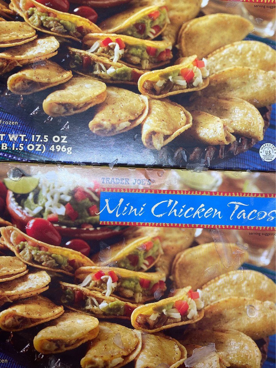 Boxes of frozen mini chicken tacos from Trader Joe's.