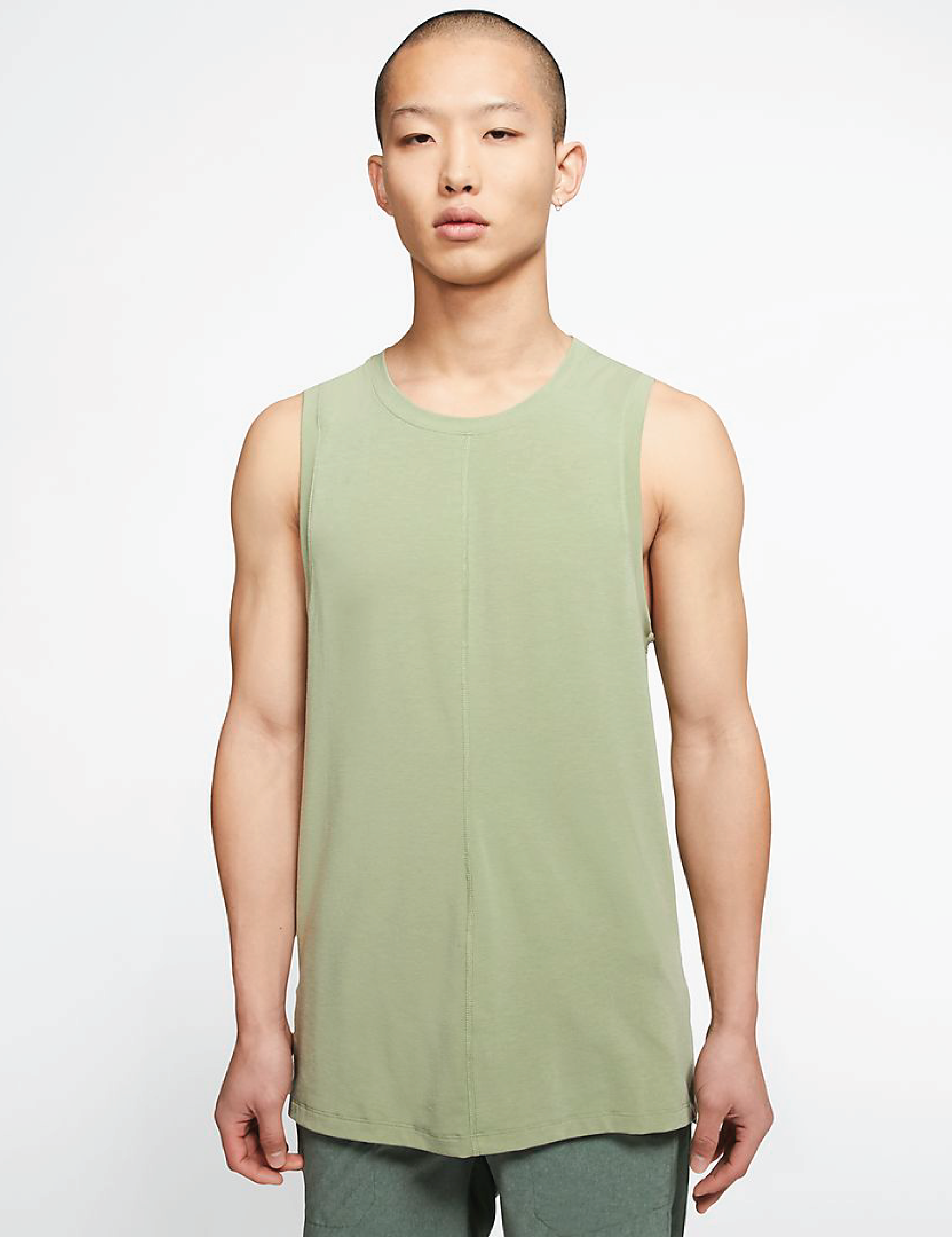 A model wearing a the green, scoop neck, yoga tank