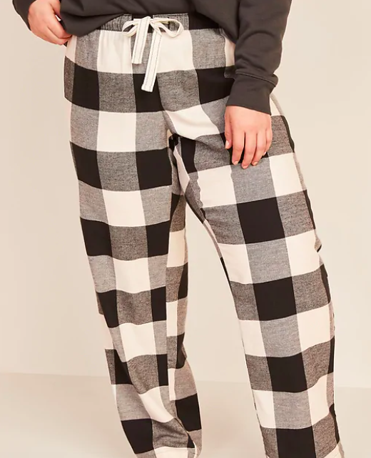 a pair of pants in black and white checkered pattern