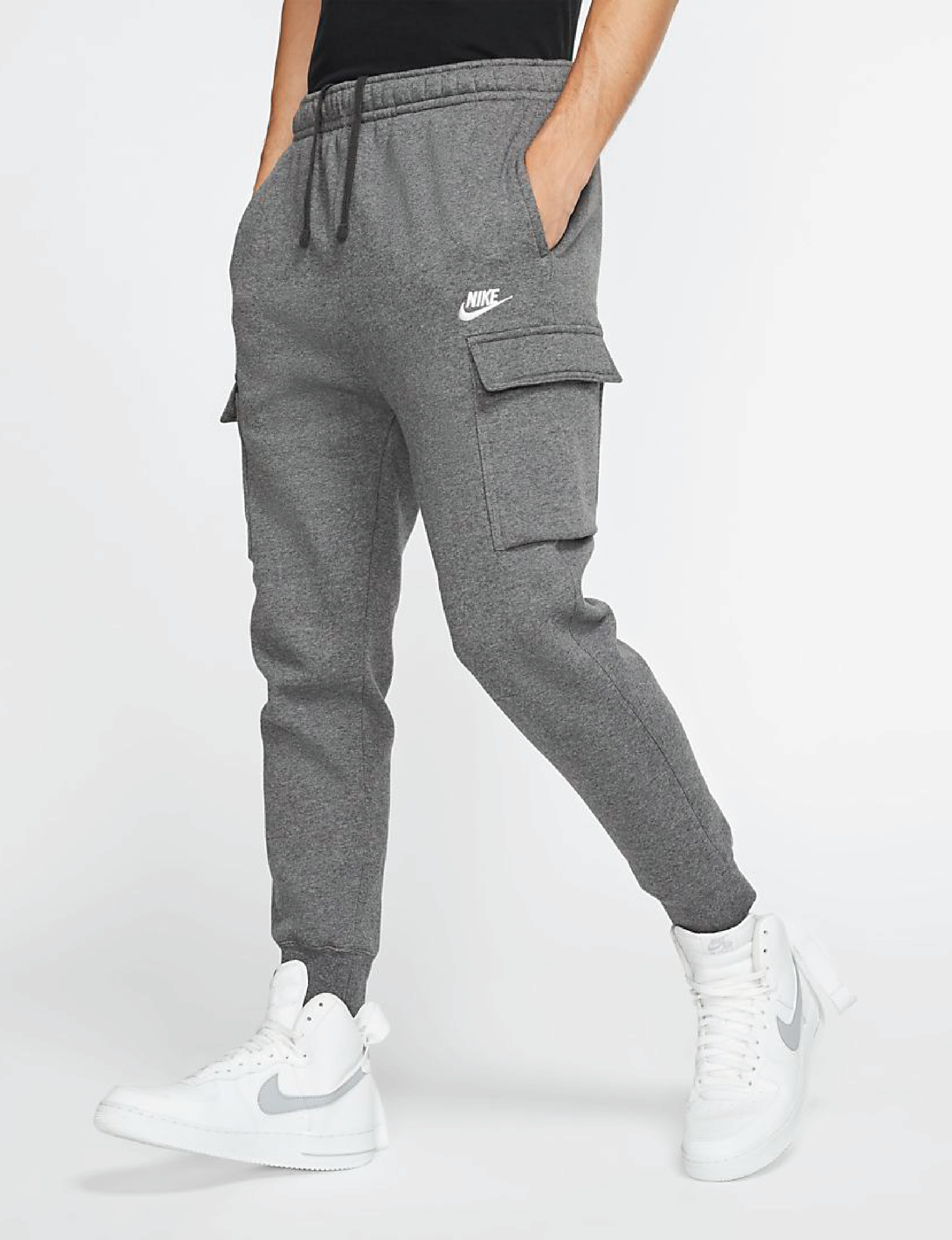 A model wearing cargo fleece pants with four pockets and elastic waistband