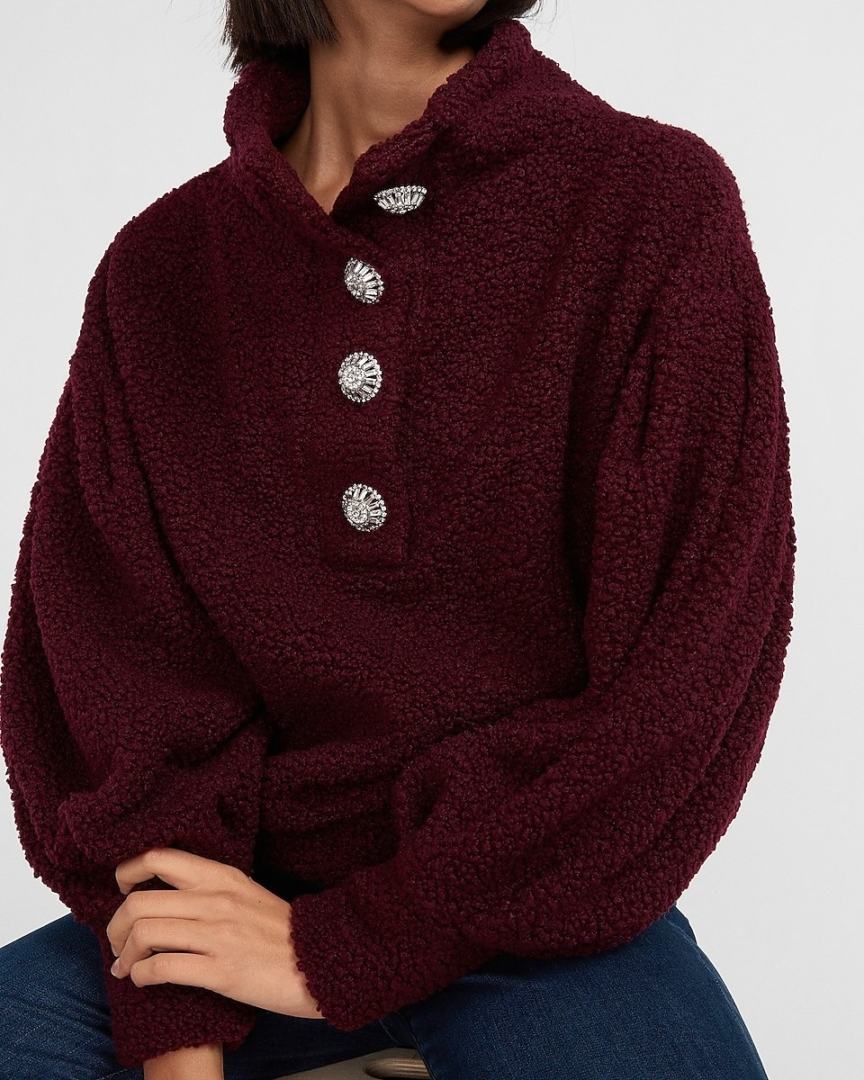 a burgundy sherpa sweatshirt with silver jeweled buttons down the front
