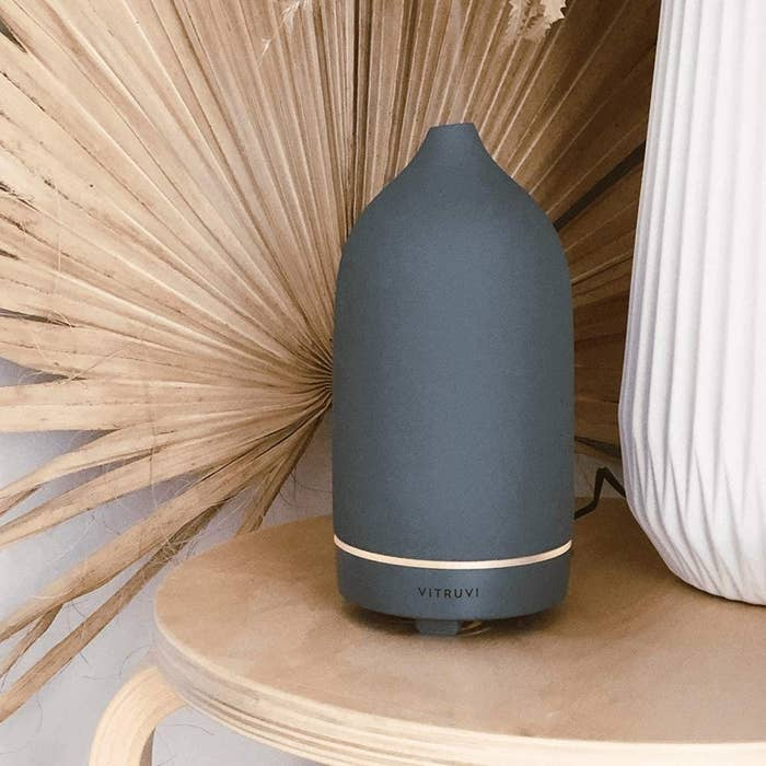 The oval-shaped diffuser with steam coming out of the top in dark grey
