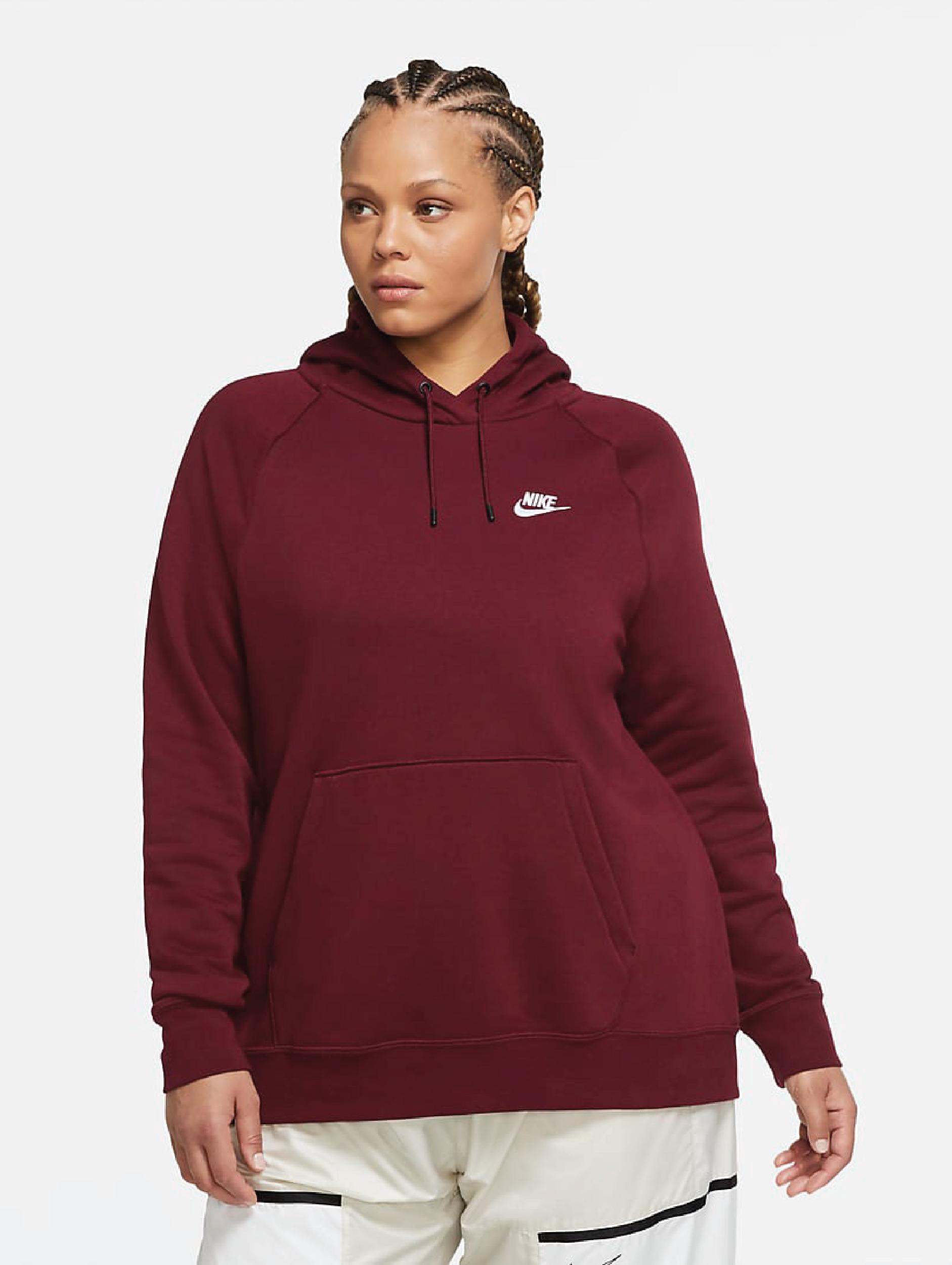 A model wearing the deep red hoodie