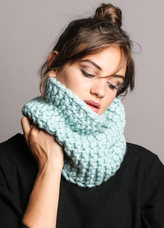 a model wearing a light blue knit snood