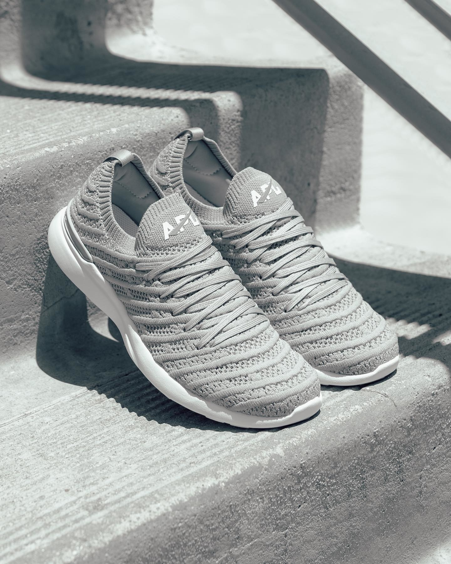 The knit sneakers in grey with grey laces and white soles