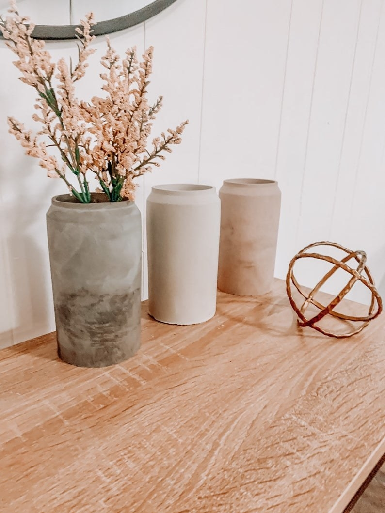 three concrete vases in different tones