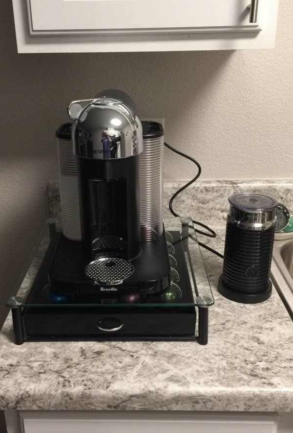 Reviewer pic of the machine, plus the aeroccino milk frother next to it and a drawer of pods under it