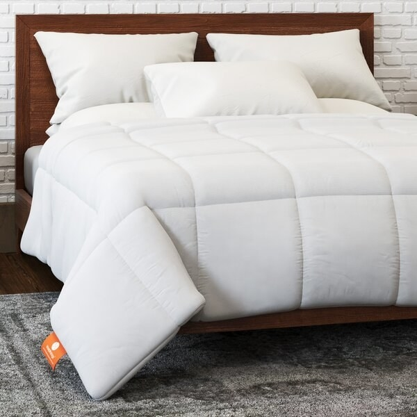 The comforter, which is white, quilted in a square pattern, and slim, rather than fluffy