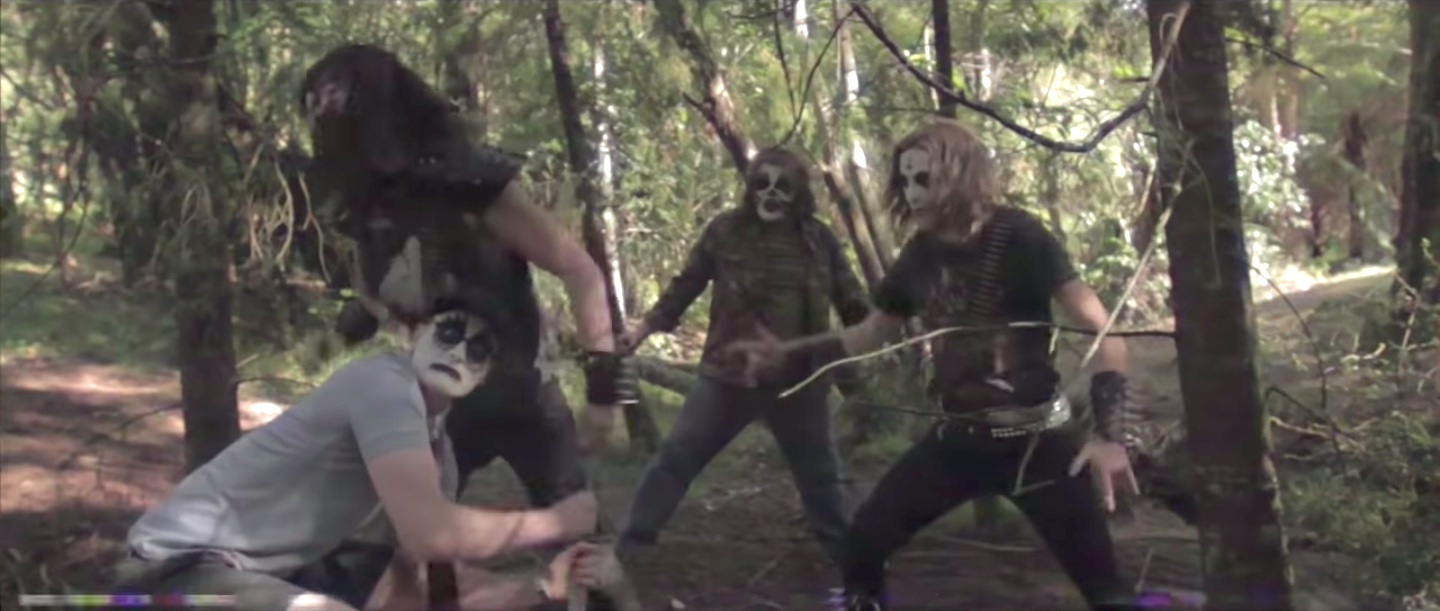 Milo Cawthorne. James Blake, Sam Berkley, and Daniel Cresswell wearing black and white face paint in Deathgasm