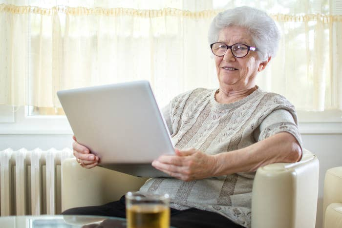 An old lady looking at a computer