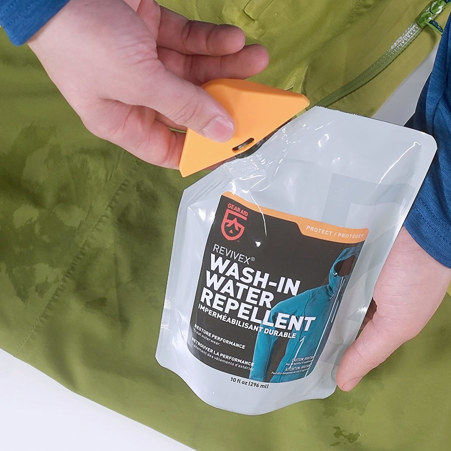 A person opening a packet of wash-in water repellant