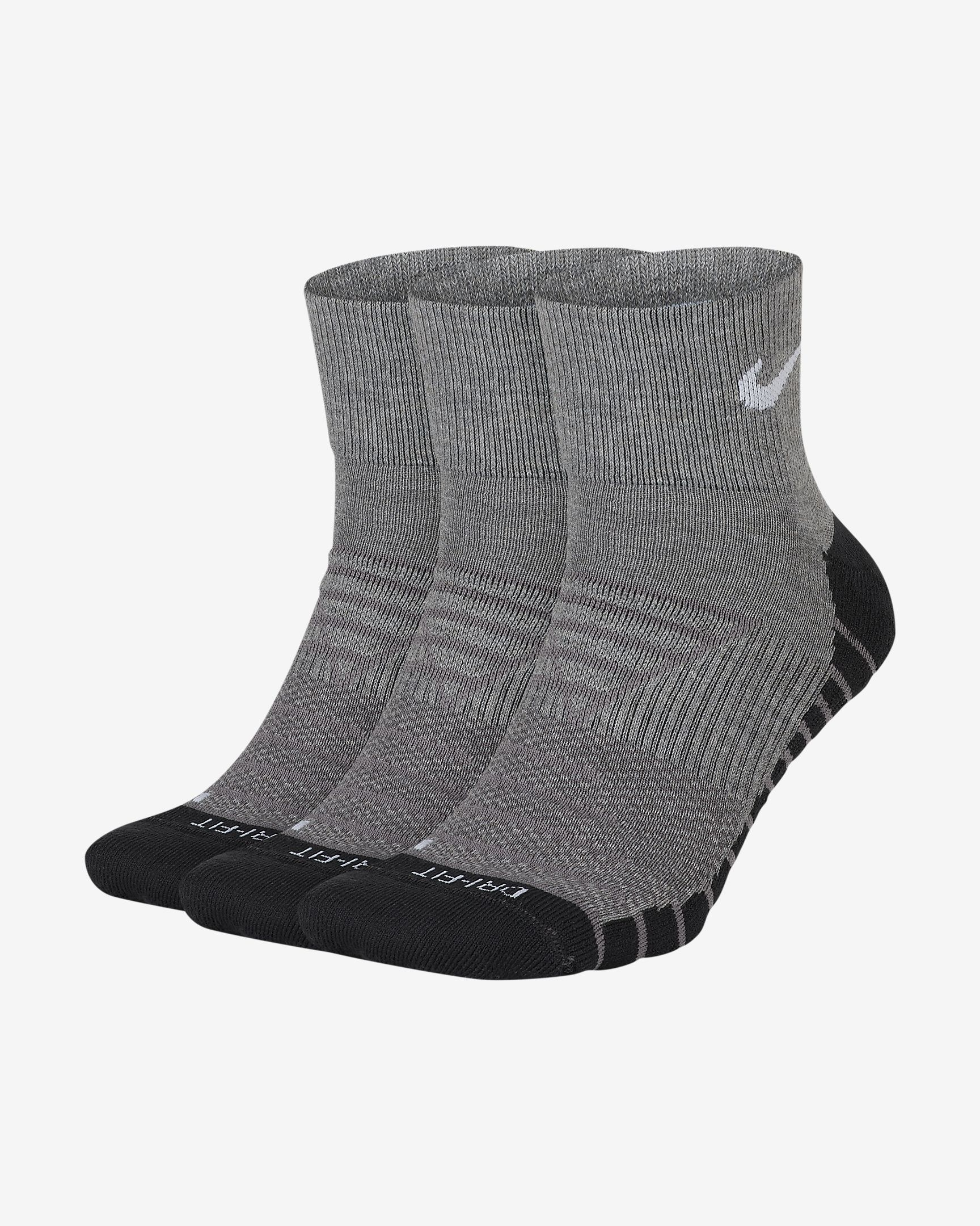 Three pairs of grey socks with black toes