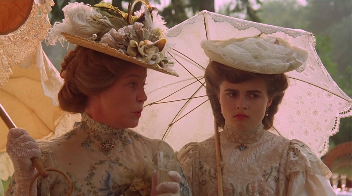 "Helena Bonham Carter looks bored while standing under an umbrella in ""a room with a view"""