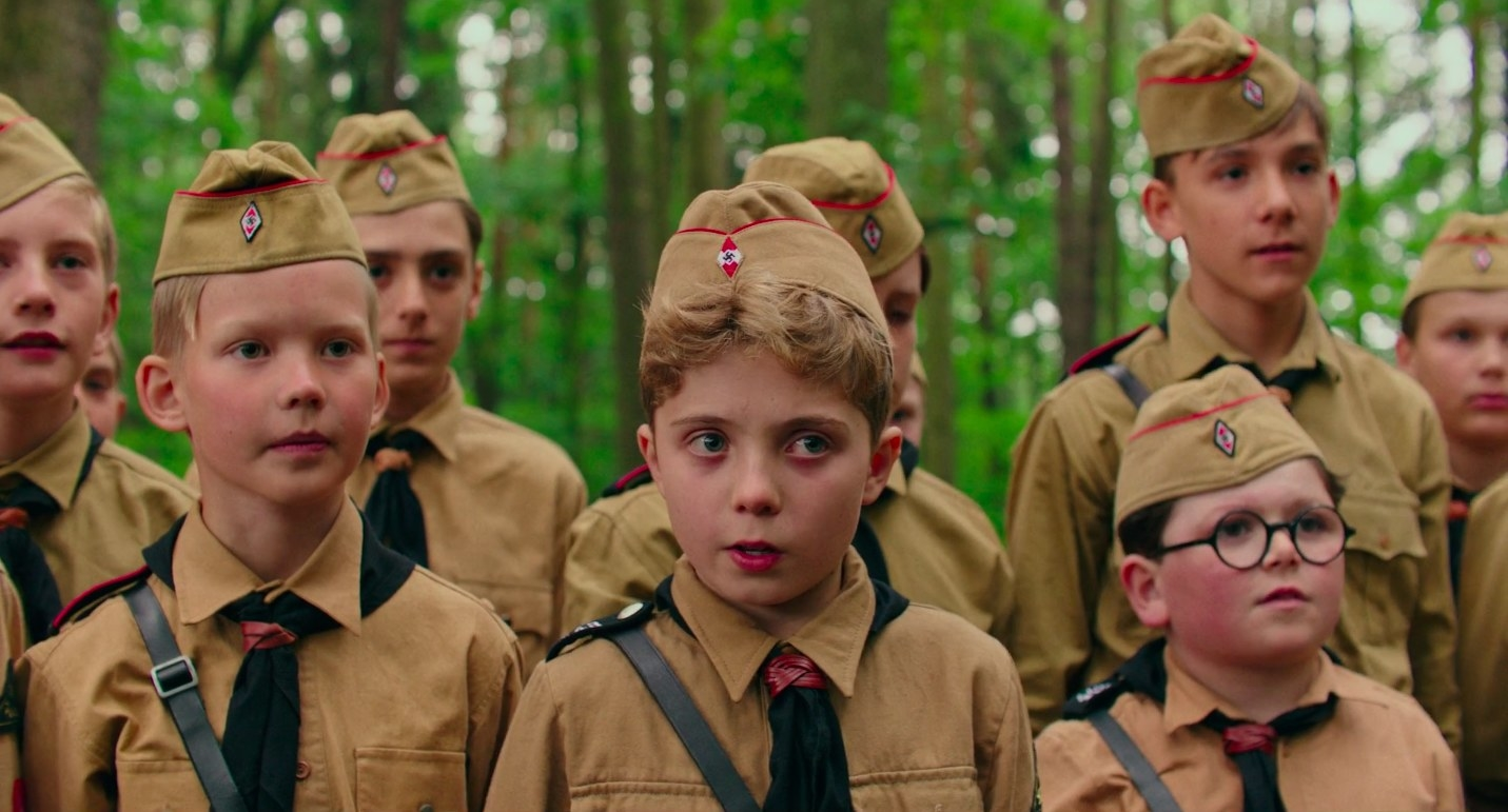"a group of hitler youth in the woods in ""jojo rabbit"""