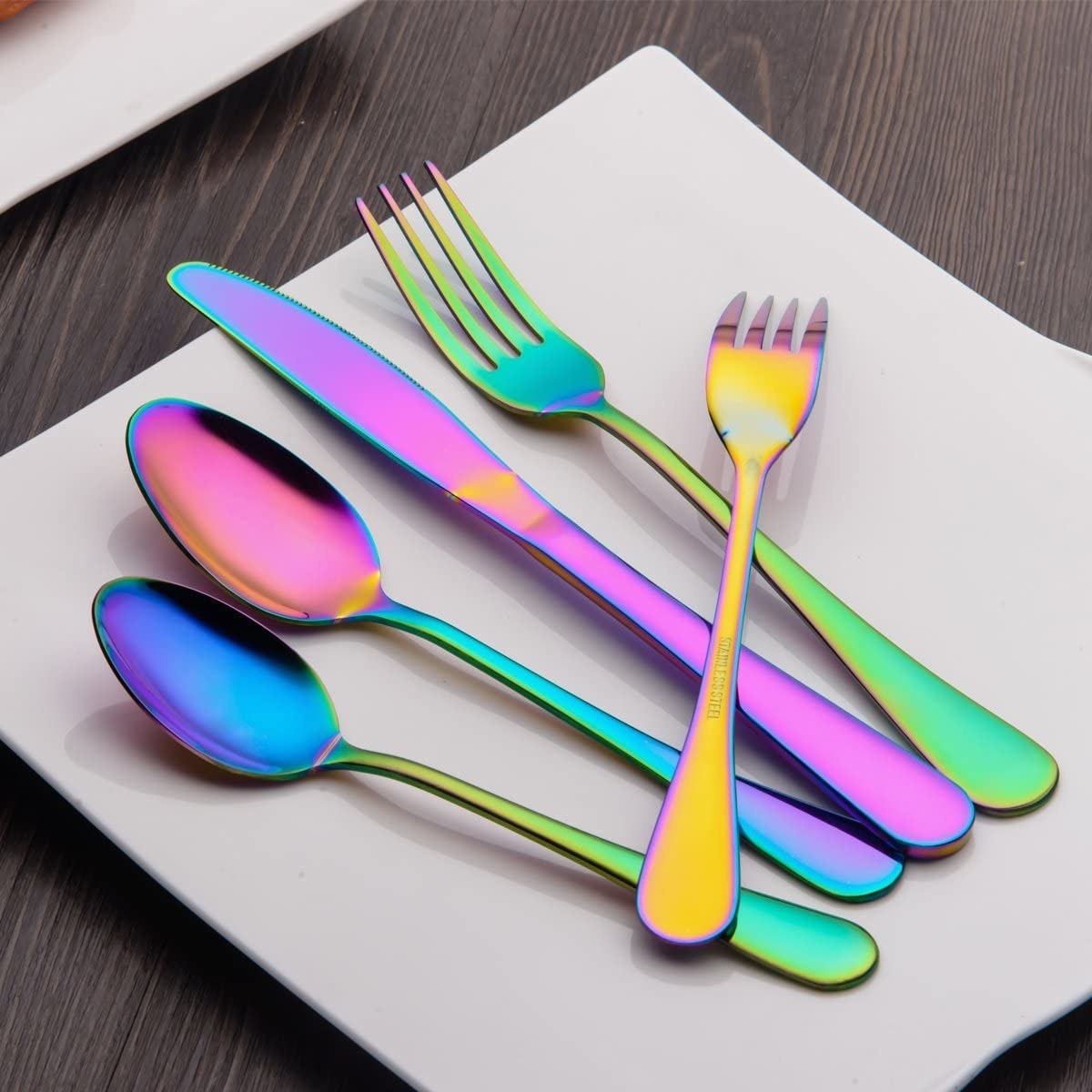 Rainbow tinted silverware on a plate