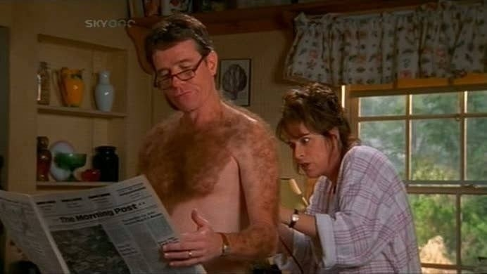 Lois shaving Hal's entire body as he reads the morning paper.