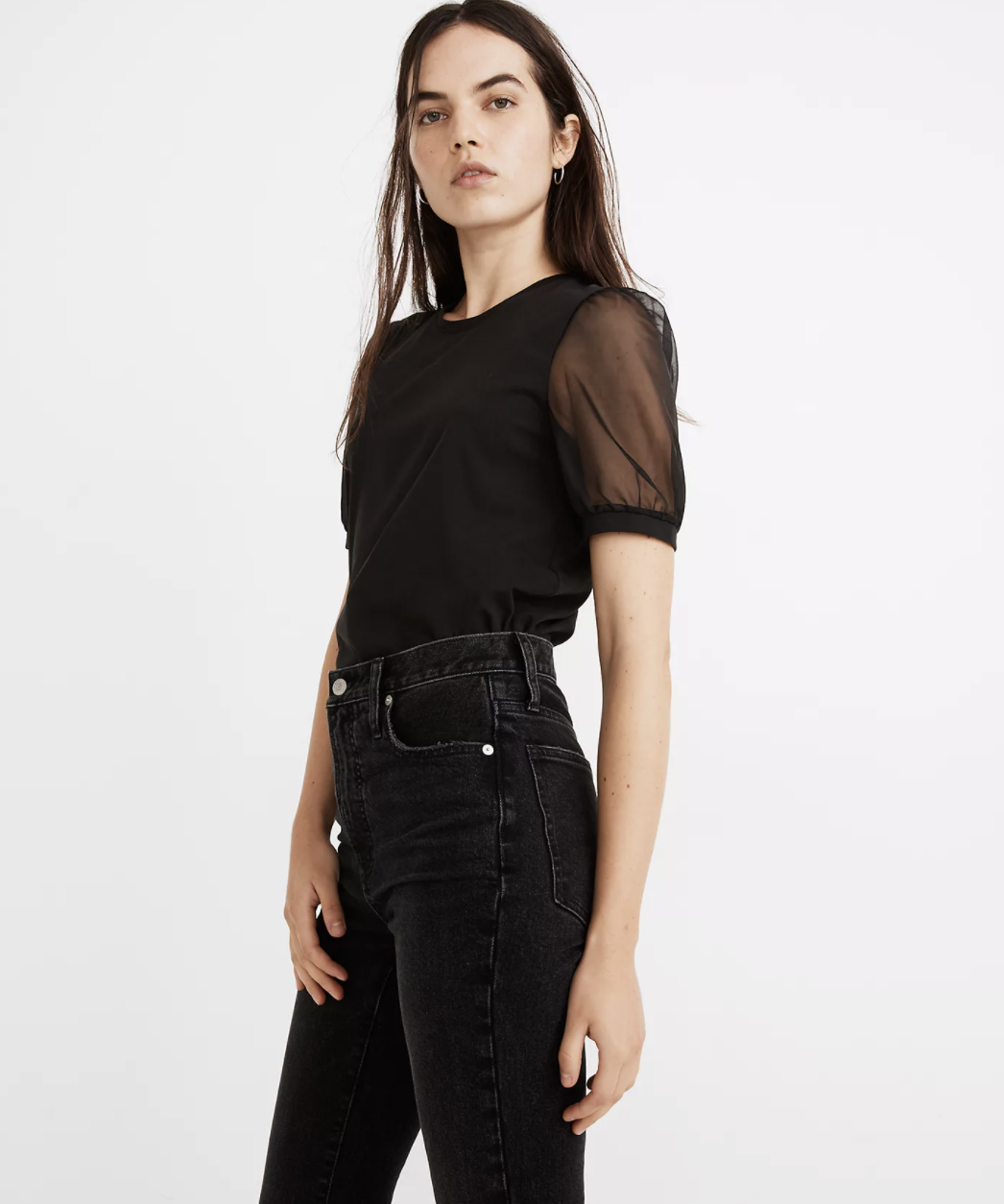 the top in black, tucked in