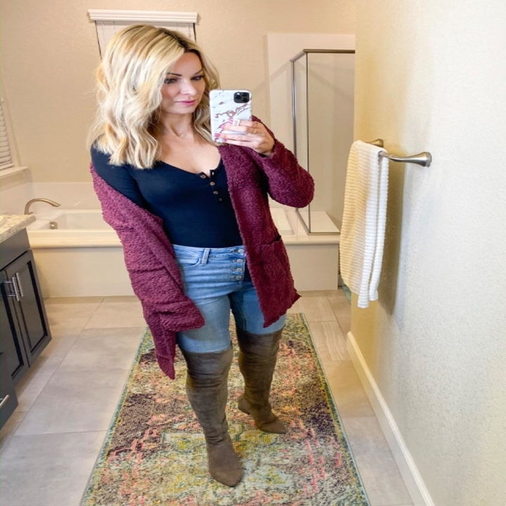 reviewer wearing the cardigan in burgundy