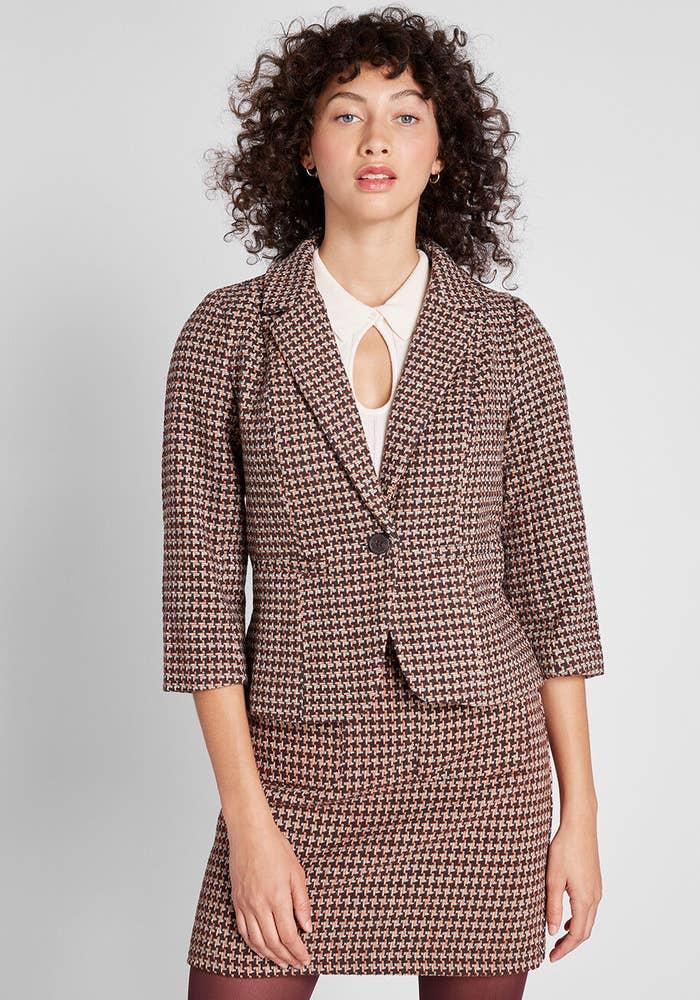 Model wearing informed ensemble plaid blazer