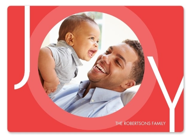 Model and child on red 5x7 premium card that says Joy