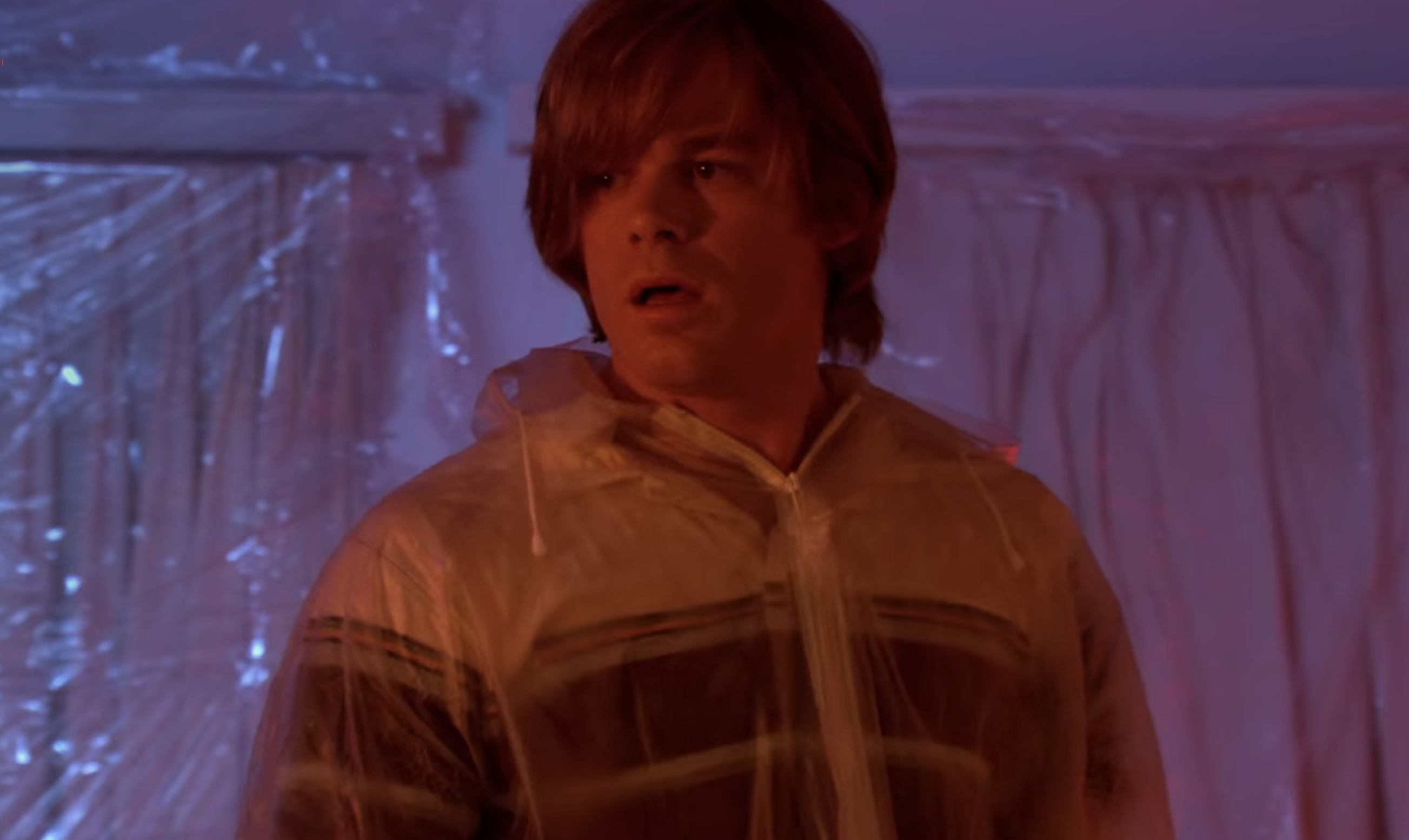 Michael C. Hall wearing a wig with long bangs