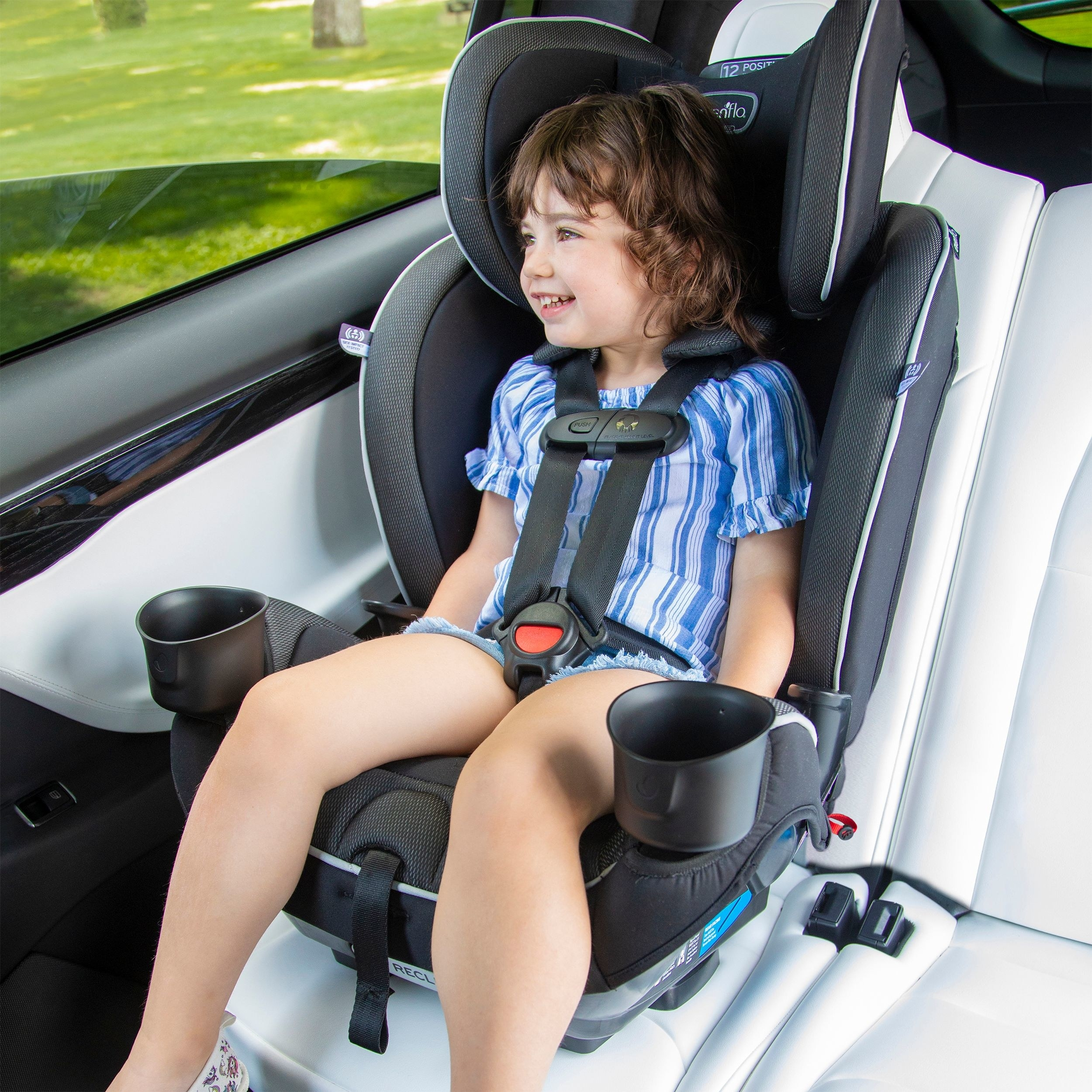 child sitting in a car set while looking out the car window